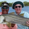 "Ron with his 39 1/2"" Snook pushing 30 pounds caught on 10 lb. tackle on a pilchard under a cork!"