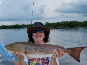 "Melissa put the pain on this 30"" bruiser redfish!!!"
